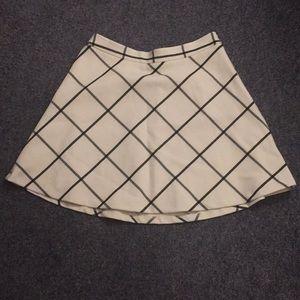 cream and black skirt